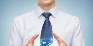 Business And Office Advertising People Concept Friendly Young Buisnessman Holding Something In His Hand