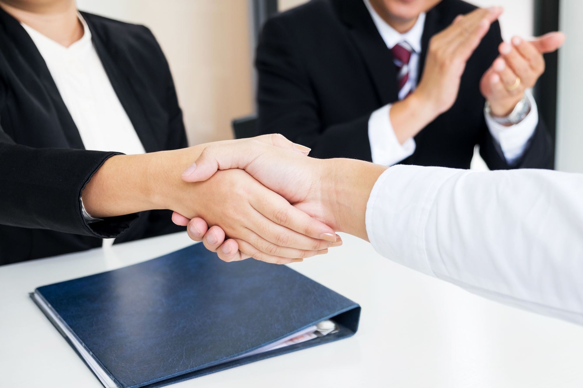 Successful Business Team Shaking Hands With Eachother In The Office Job Interview Concept