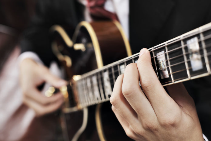 Jazz Musician Playing With Electric Guitar Short Depth Of Field