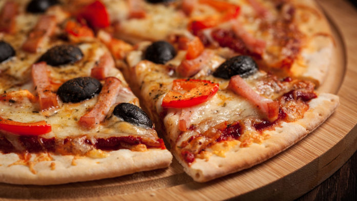 Letterbox Panorama Of Sliced Ham Pizza With Capsicum And Olives On Wooden Board On Table Ham Pizza Close Up Letterbox