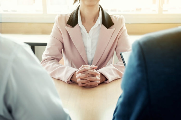 Beautiful Woman And Her Job Interview In Office Work