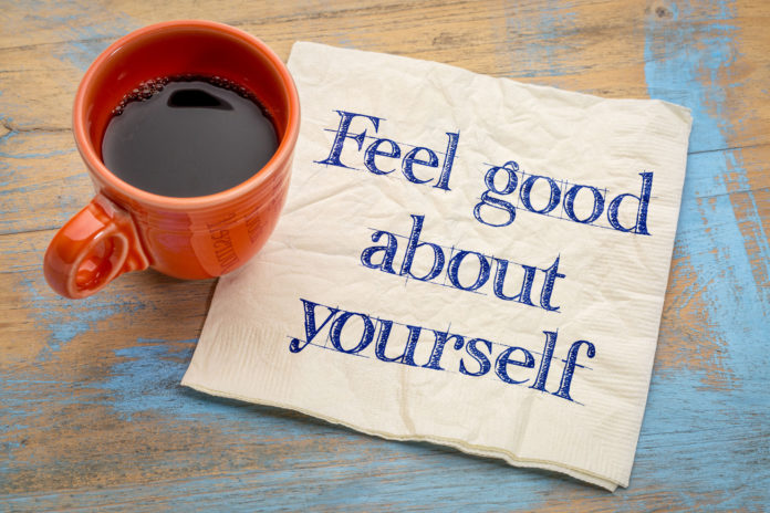 Feel Good About Yourself Motivational Advice Handwriting On A Napkin With A Cup Of Espresso Coffee
