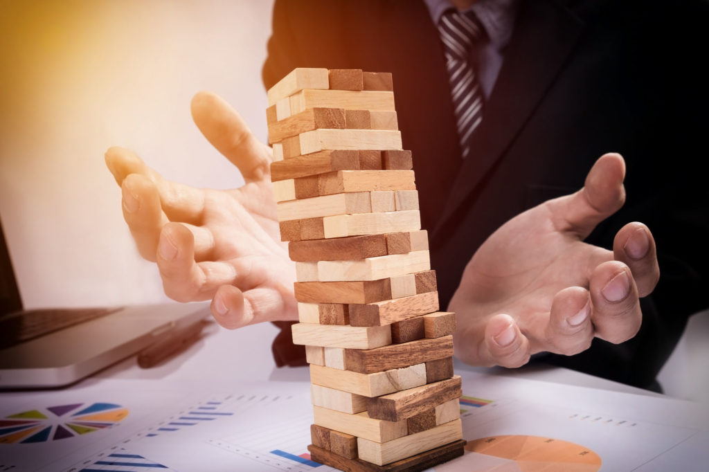Planning Risk And Strategy In Business Concept Businessman Gambling Placing Wooden Block On A Tower
